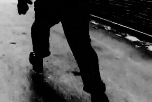 a scene of a man walking on the street