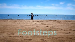 Footsteps texts with a man walking in daytime beach background